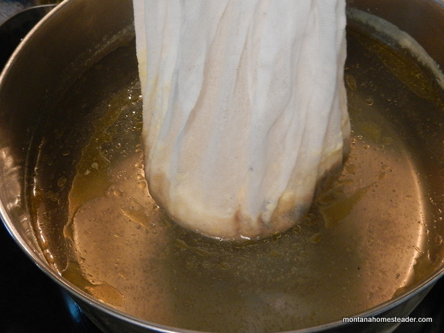 honeycomb melting and beeswax seeping out of cheesecloth when rendering beeswax from honeycomb