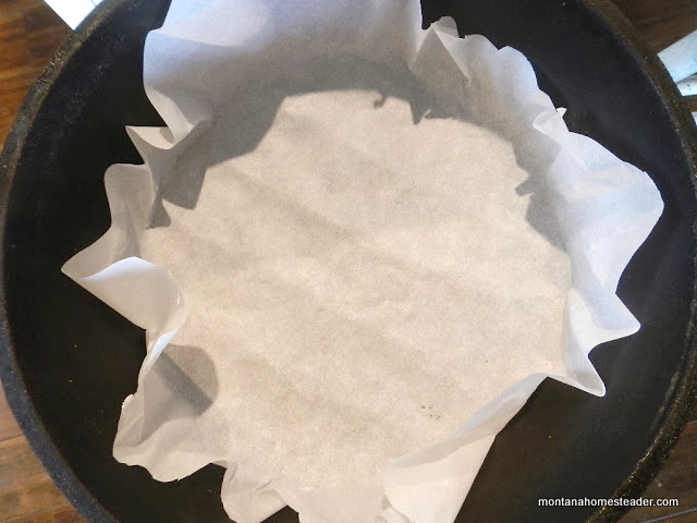 lining a dutch oven with parchment paper for easier clean up after baking