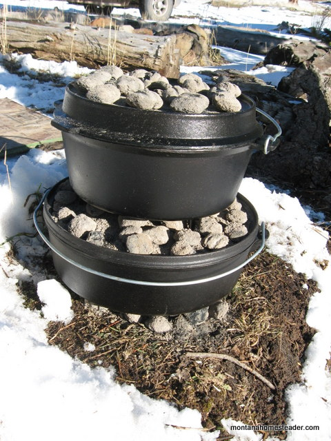 outdoor cooking in cast iron dutch ovens in the cold snow in Montana | Montana Homesteader