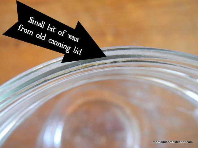 Inspecting canning jar rim for leftover wax from old canning lid | Montana Homesteader