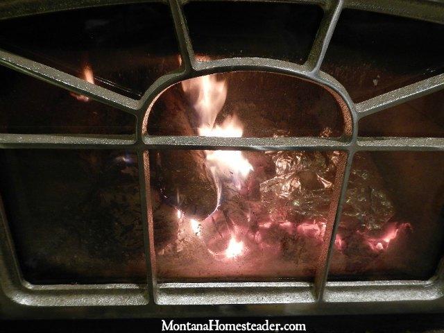 Baking potatoes inside a wood stove | Montana Homesteader