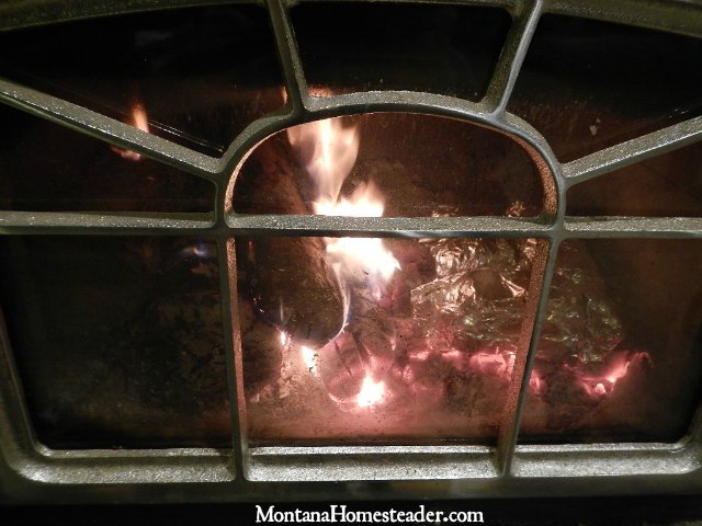 Baking potatoes inside a wood stove | Montana Homesteader