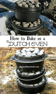Dutch ovens stacked together with coals baking outside at camp in the snow