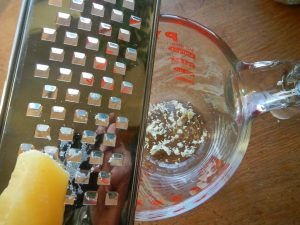 Grating beeswax for easy DIY natural lip balm recipe